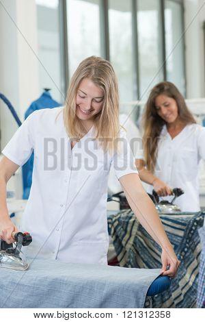 two women ironing