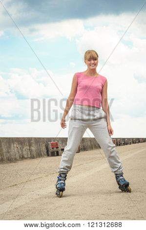 Young Female Exercise Outdoors Ride On Rollerblades.