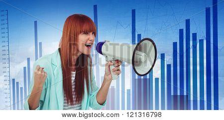 Hipster woman shooting through megaphone against blue data