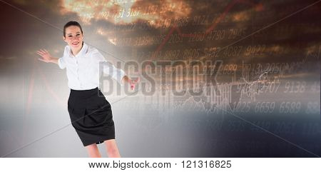 Businesswoman performing a balancing act against stocks and shares