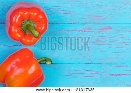 Orange Bell Peppers Over Blue Wood Background