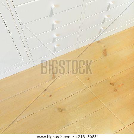 White Dresser On Wooden Floor