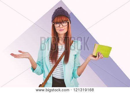 Smiling hipster woman with bag and book against colored background
