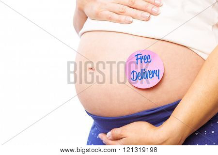 Pregnant woman with sticker on bump against free delivery