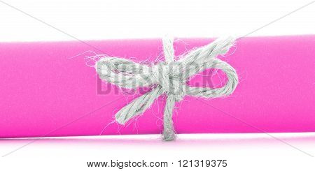 Handmade Natural String Bow Tied On Pink Message Scroll Isolated