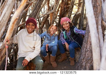 Group Of Children Playing In Forest Camp Together
