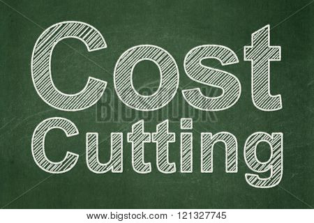 Business concept: Cost Cutting on chalkboard background