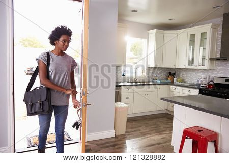 Woman Coming Home From Work And Opening Door Of Apartment