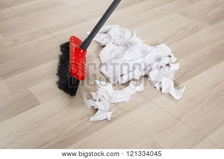 Broom With Torn White Papers