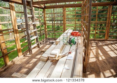 Worktools On Stacked Wooden Planks At Construction Site