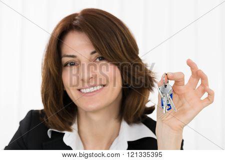 Happy Businesswoman Holding Key