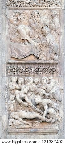 BOLOGNA, ITALY - JUNE 04: Isaac blesses Jacob by Ercole Seccadenari up and Burial of Jacob's wife by Amico Aspertini, left door of San Petronio Basilica in Bologna, Italy, on June 04, 2015