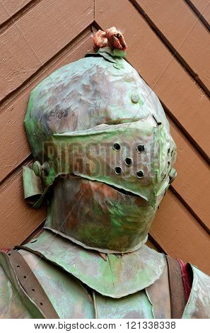 Knight steel helmet armour on a wooden door