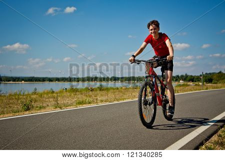 Urban biking - teenage boy riding bike