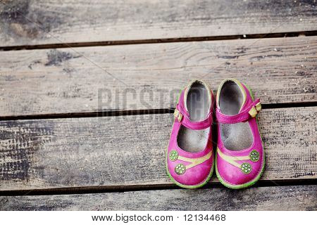 Girl's small shoes on wood