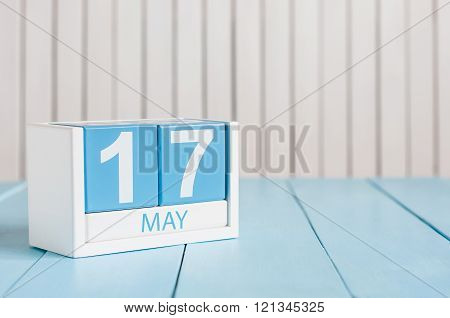 May 17th. Image of may 17 wooden color calendar on white background.  Spring day, empty space for te