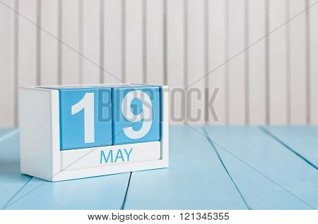 May 19th. Image of may 19 wooden color calendar on white background.  Spring day, empty space for te