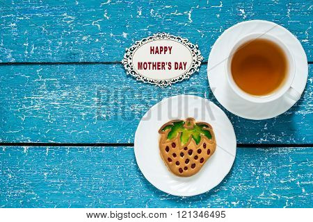 Cookies In The Form Of Strawberries And Tea For Mom