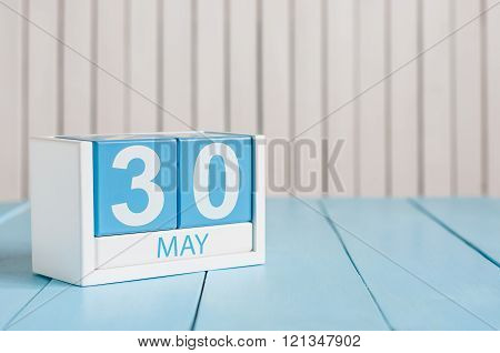 May 30th. Image of may 30 wooden color calendar on white background.  Spring day, empty space for te