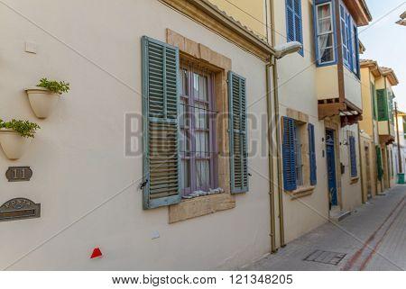 Nicosia, Cyprus - 26 February, 2016:  Classic houses with beautiful windows in Chrysaliniotissa, Old Nicosia in Cyprus within the Venetian Walls