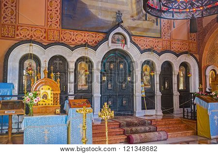 JERUSALEM ISRAEL - FEBRUARY 16 2016: The iconostasis in Russian Orthodox Church of Mary Magdalene made of dark wood with white stone frames on February 16 in Jerusalem.
