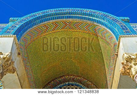 JERUSALEM ISRAEL - FEBRUARY 16 2016: The entrance canopy to the Dome of the Rock decorated with the golden mosaics and glazed tiles on February 16 in Jerusalem.