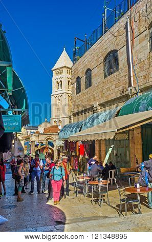 JERUSALEM ISRAEL - FEBRUARY 16 2016: The Aftimos Suq is the crowded place tourists often visit it after the neighboring Church of the Holy Sepulchre on February 16 in Jerusalem.