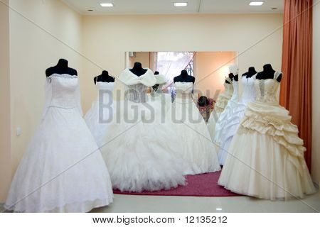 Shop window with wedding dresses on mannequins