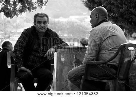 Men drinking tea in Baku, black and white