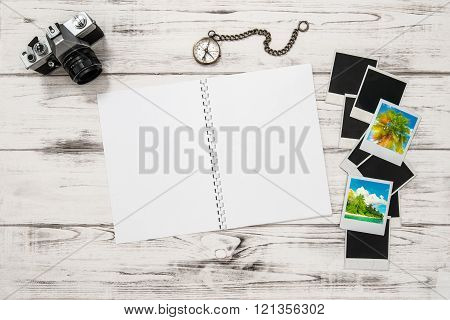 Open travel book photo camera kompass photo frames holidays pictures