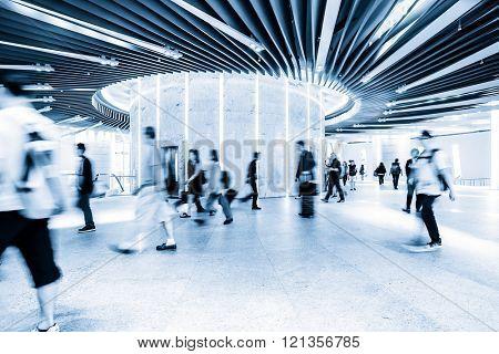 people walking in corridor