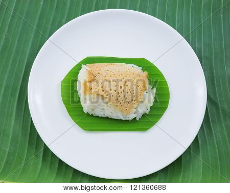sticky rice with steamed custard on banana leaves and dish, sweet sticky rice, Thai sweet dessert, o