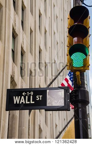 Wall Street Sign with Green Traffic Light
