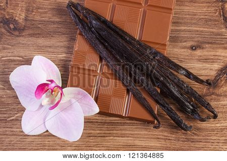 Milk chocolate, fragrant vanilla sticks and blooming orchid