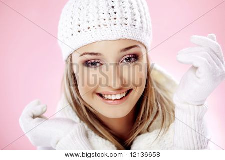 Close-up portrait of beautiful pure young woman wearing warm winter clothing