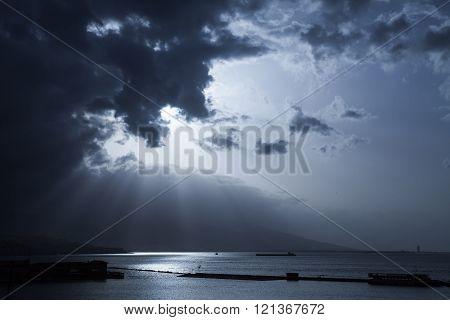 Sunlight Goes Through Dark Stormy Clouds
