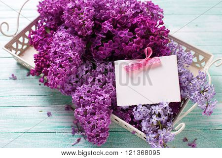 Splendid Lilac Flowers On Tray And Empty Tag On Turquoise Painted Wooden Planks.