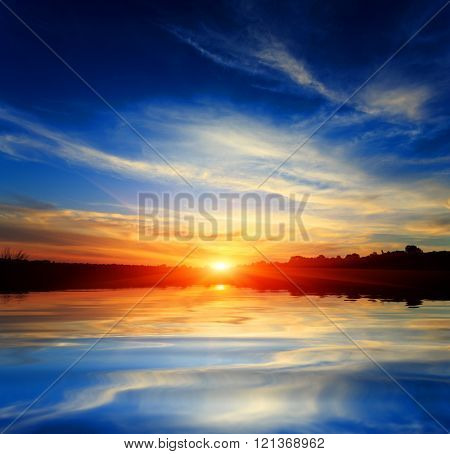 Nice sunset over lake water surface
