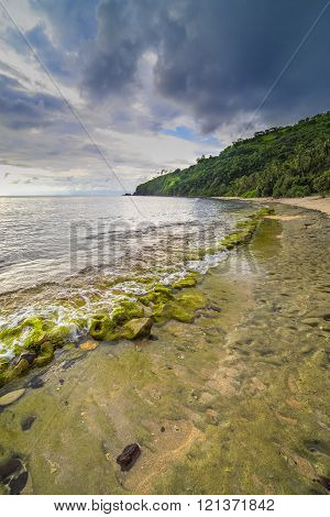 Natural rock mosses with cloudy skies at Lombok Island, Indonesia