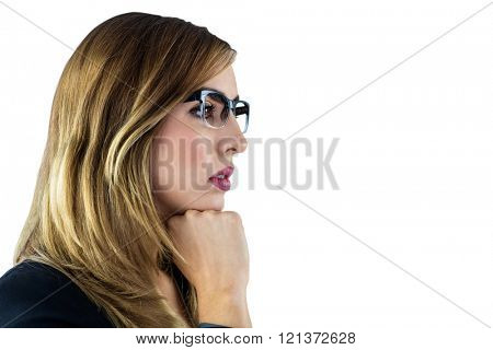 Woman touching her chin with her fist on white background