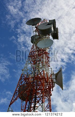 Communications Tower With A Beautiful Blue Sky