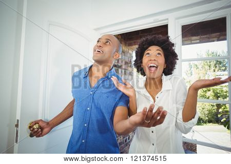 Happy couple entering in their house and cheering