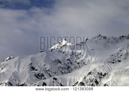Sunlight Mountain Peak And Cloudy Sky In Evening
