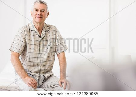 Peaceful senior man smiling at home