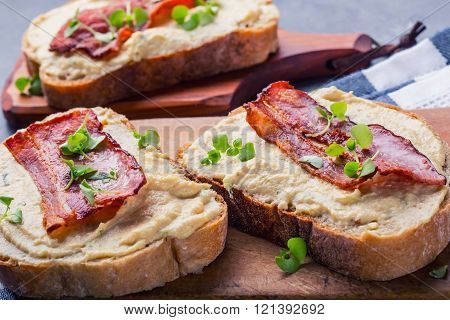 Spreads. Egg spread, grilled bacon, bread young basil leaves, Herb decoration.