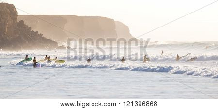 Surfers surfing on El Cotillo beach, Fuerteventura, Canary Islands, Spain.