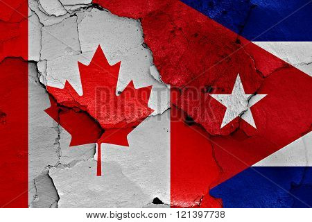Flags Of Canada And Cuba Painted On Cracked Wall