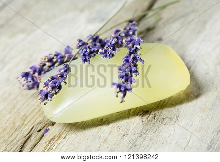 Lavender soap with lavender flower on old garden table