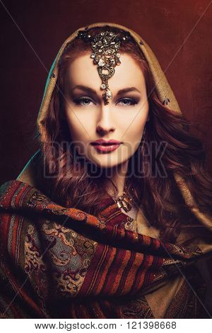Beautiful young woman in shawl