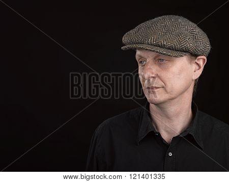 Male model wearing a patterned side hat
